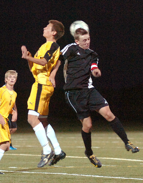 Thompson Valley's #16 Michael McKenna, left, and Loveland High's #10 Luke Chapman go up for a header during their game Saturday night at the Loveland Sports Park.