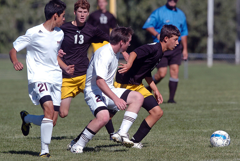 Thompson Valley High School's Seth Rickard, right, and Joe Dennis (13) track down the ball along with Berthoud's Axel Ayala (21) and Parker Owens (20) in the first half of their game Saturday at Marr Field in Berthoud.