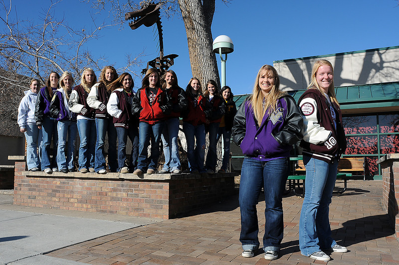 Amy Ekart, right, of Berthoud High School is this year's Player of the Year and Kelly Scribner, second from right, of Mountain View High School, is this year's Pitcher of the Year. The All Area Softball Team from left are, Jessica Shadowen, Kellie Eastman and Ashlee Dennis of Mountain View, Amy Krause, Lindsey Ludwig and Kaitlyn Bending of Berthoud, Haley Burge, Amanda Farrell, Bradey King and Cassidy Smith of Loveland High School and Morgan Rohrbouck of Thompson Valley High School.