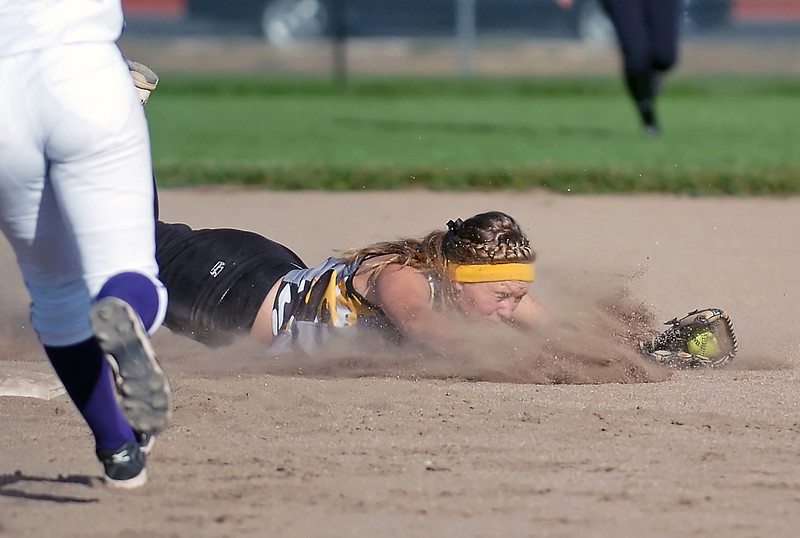 Thompson Valley High School shortstop Alexis Hunt makes a diving catch for the third out in the bottom of the first inning of a game against Mountain View on Thursday, Oct. 7, 2010 at MVHS.