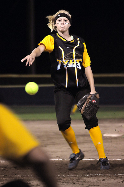 Sophomore Ashleigh Roth of Thompson Valley High School pitches during the 2nd inning of Monday night's game against Loveland High School at Centennial Field.