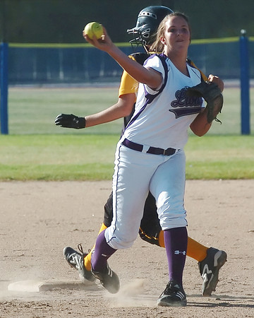 Mountain View High School shortstop Kellie Eastman makes the throw to first to complete a double play after forcing out Thompson Valley baserunner Lauren Mattson at second during their game on Thursday, Sept. 16, 2010 at Centennial Field.