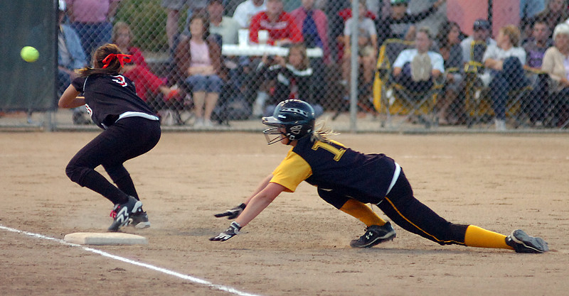 Thompson Valley High's #10 Marissa Barnhart tries to get back to first base before Loveland High's #3 Chanley Burge tags her out.