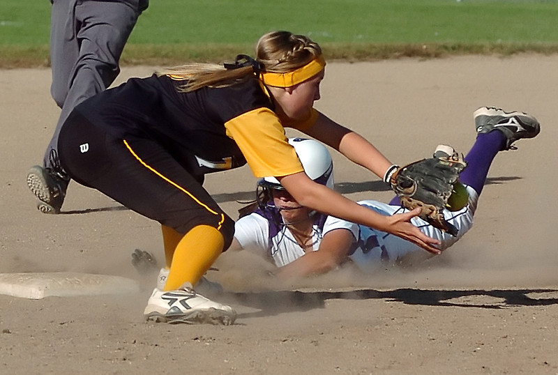 Mountain Veiw High School's Talish Veach slide headfirst into second base for a steal ahead of the throw to Thompson Valley second baseman Alexis Hunt in the bottom of the third inning of their game on Thursday, Sept. 16, 2010 at Centennial Field.