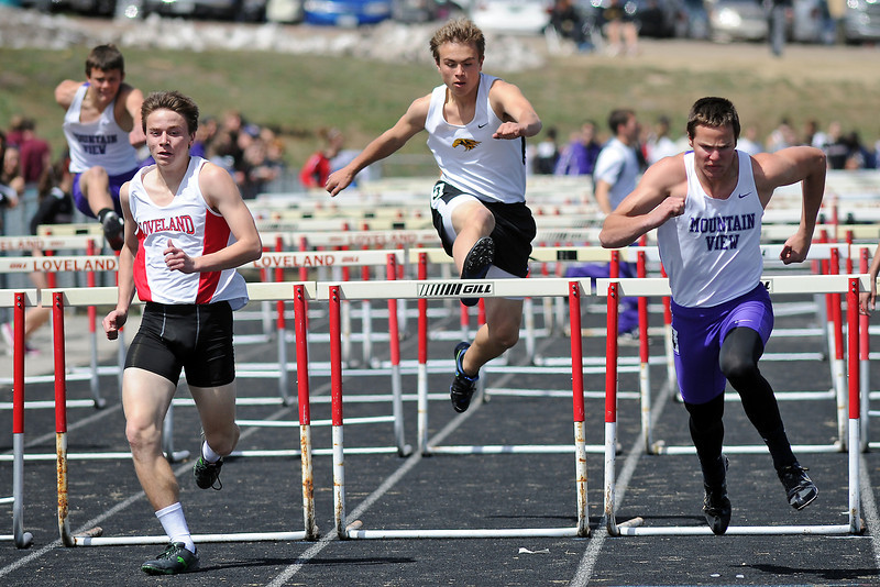 Loveland High School senior Joe Etling, left, Thompson Valley freshman Tanner Wall and Mountain View senior Tyler Kress compete in the 110-meter hurdles during R2J Invitational meet on Wednesday, April 24, 2013 at LHS.