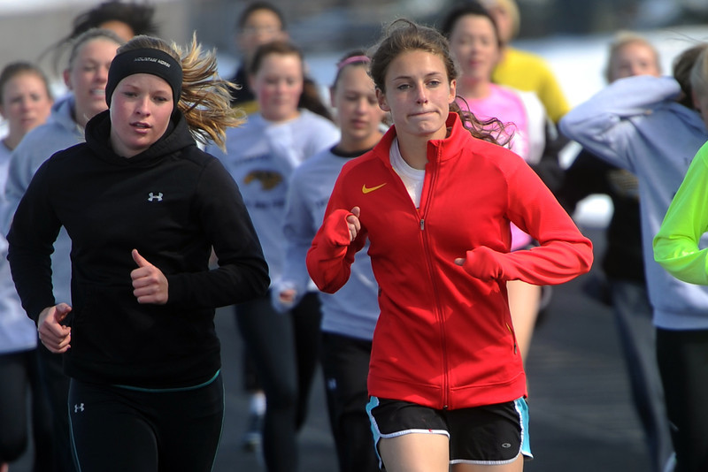 Thompson Valley High School sophomore Lindsey Kroboth, right, runs with teammates during warmup at the start of track practice Tuesday, April 23, 2013 at TVHS.
