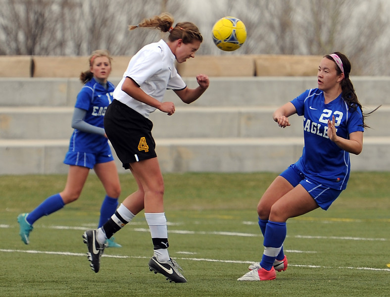 Thompson Valley High School soccer player #4 Paige Chase, left, and Broomfield's #23 Kayla Snyder during their game at the Loveland Sports Park on Tuesday, April 30, 2013.
