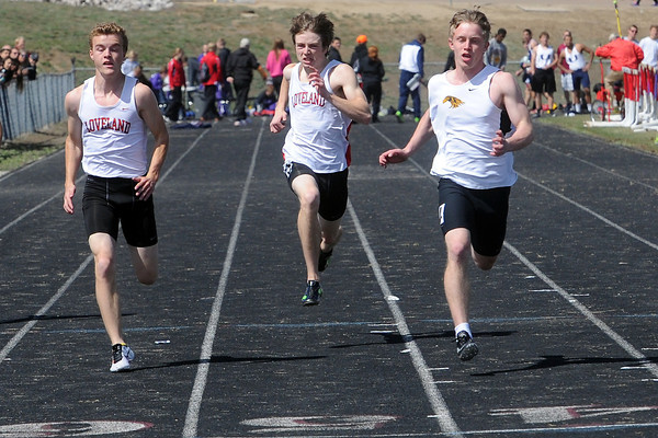 Loveland High School's Trevin Long, left, and Dylan Miller and Thompson Valley's Andrew Bradberry compete in a heat of the 100-meter dash during the R2J Invitational meet on Wednesday, April 24, 2013 at LHS. (Photo by Steve Stoner)