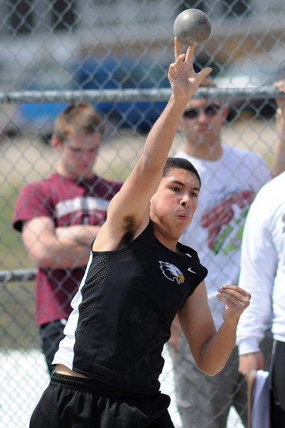 Thompson Valley High School sophomore Cody Marvin makes a throw while cometing in the shot put event during the R2J Invitaional meet on Wednesday, April 24, 2013 at Loveland High School.