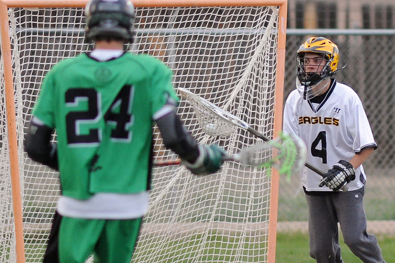 Thompson Valley High School goalie Tim Zimmerman (4) works in front of the net against St. Mary's midfielder Daniel Padrnos after making a stop in the first quarter of their game on Tuesday, May 7, 2013 at Patterson Stadium.