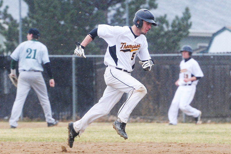 Thompson Valley High School baserunner Drew Meintzer sprints between second and third base on his way to home plate for a score in the bottom of the third inning of a game against Fossil Ridge on Tuesday, April 2, 2013 at Constantz Field.