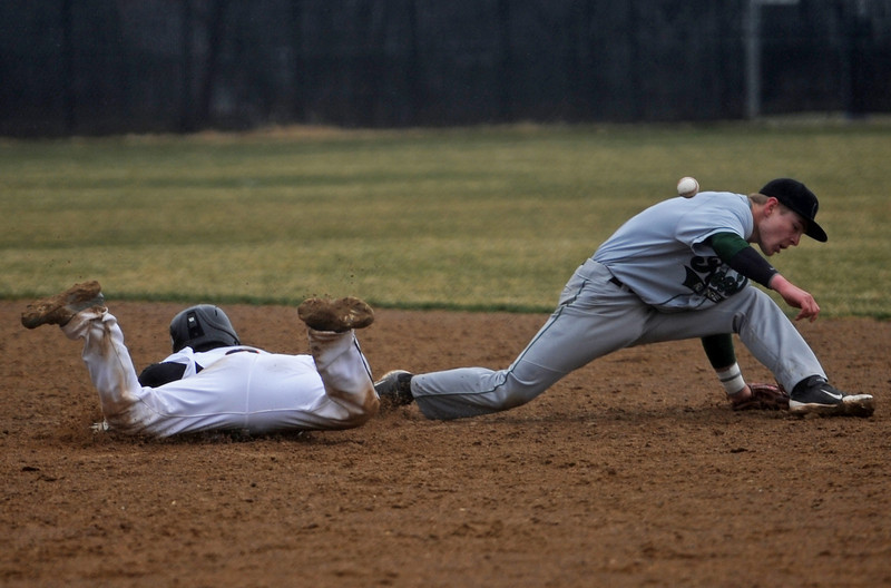 0403 SPO TVHSBaseball02 tfh.jpg Thompson Valley High School senior DJ Grine slides into second base safely on an error by Fossil Ridge senior Hunter Donaldson during the fifth inning of a Tuesday afternoon baseball game played at TVHS in Loveland, Colo. (Photo by Timothy Hurst)