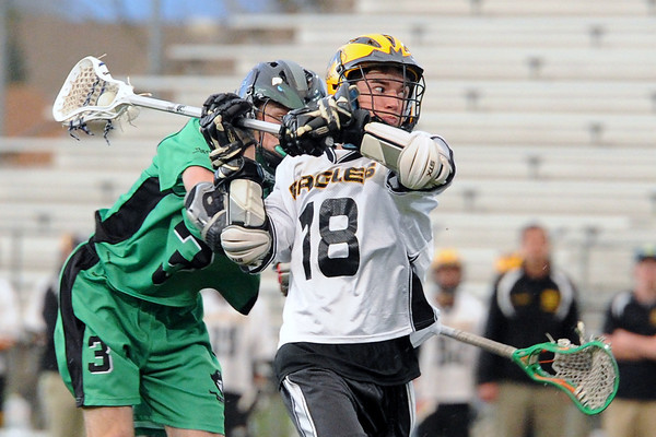 Thompson Valley High School's Brian McGhie (18) takes a shot in front of St. Mary's player Henry Paris in the third quarter of their game on Tuesday, May 7, 2013 at Patterson Stadium.