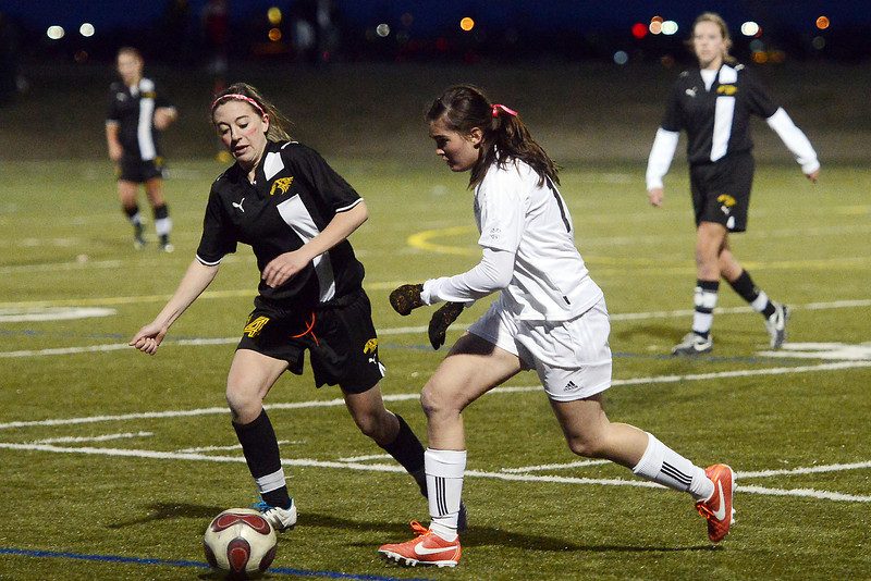 Thompson Valley High School's Alayna Maholey, left, and Loveland's Rachel Brandt chase after the ball in the second half of their game on Friday, April 12, 2013 at the Loveland Sports Park.