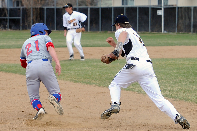 Thompson Valley High School third baseman Garrett Smith, right, runs down Centaurus baserunner Billy Miles to tag him out on a steal attempt in the top of the second inning of their game Thursday, April 11, 2013 at Constantz Field.