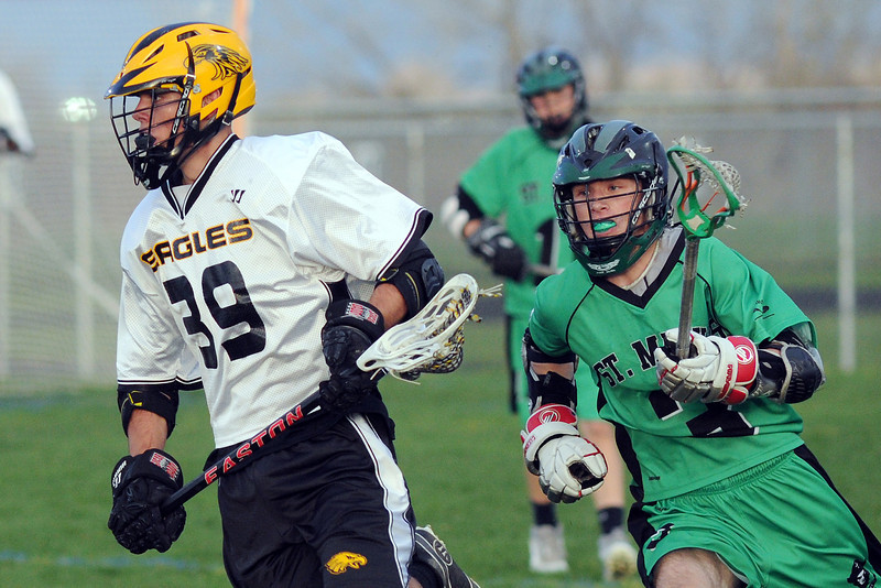 Thompson Valley High School's Jonah Warren, left, is pursued by St. Mary's player Henry Paris in the second quarter of their game on Tuesday, May 7, 2013 at Patterson Stadium.
