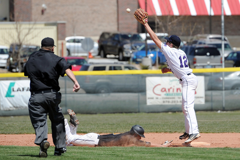 Thompson Valley High School's Drew Meintzer dives safely back to second base ahead of the tag attempt by Mountian View's Jerrod Klug in the top of the fourth inning of their game Saturday, April 27, 2013 at Brock Field.