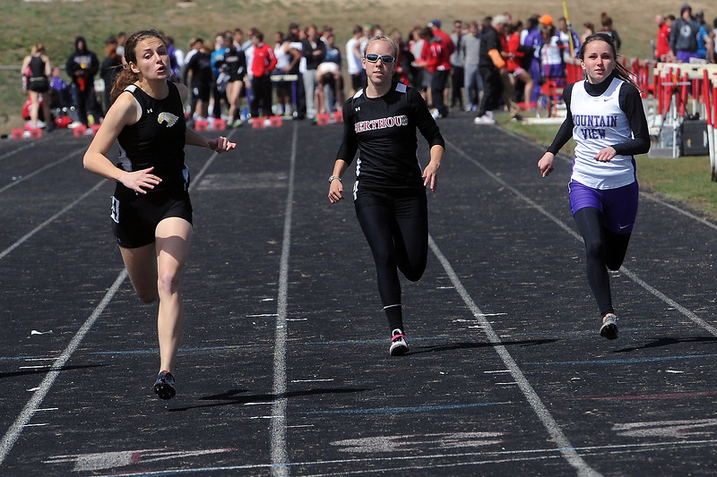 Thompson Valley High School junior Lindsey Kroboth, left, Berthoud's Hannah Kirk and Mountain View's Kacey Uhlenbrock sprint toward the finish line while competing in a heat of the 100-meter dash during the R2J Invitational meet on Wednesday, April 24, 2013 at Loveland High School.