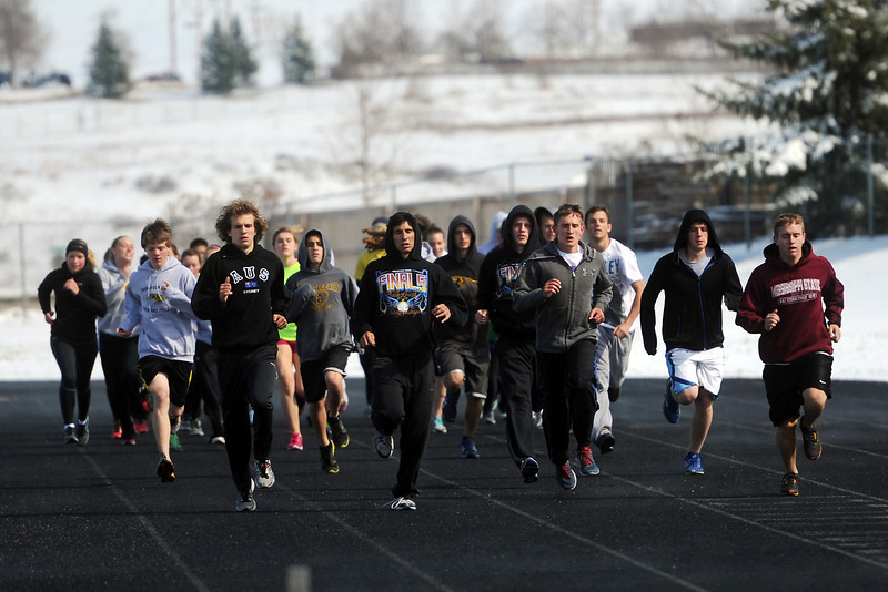Thompson Valley High School track and field athletes run warm ups at the start of practice Tuesday, April 23, 2013 at TVHS.
