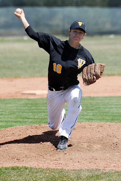 Thompson Valley High School's Garrett Smith throws a pitch in the bottom of the third inning of a game against Mountain View on Saturday, April 27, 2013 at Brock Field.