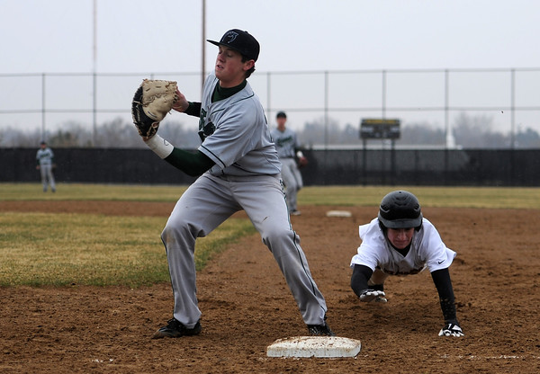 0403 SPO TVHSBaseball01 tfh.jpg Thompson Valley High School junior Jordan Parsons dives back to first base while Fossil Ridge senior Grant Johnson attempts to tag him out during the third inning of a baseball game played Tuesday afternoon at TVHS in Loveland, Colo. (Photo by Timothy Hurst)