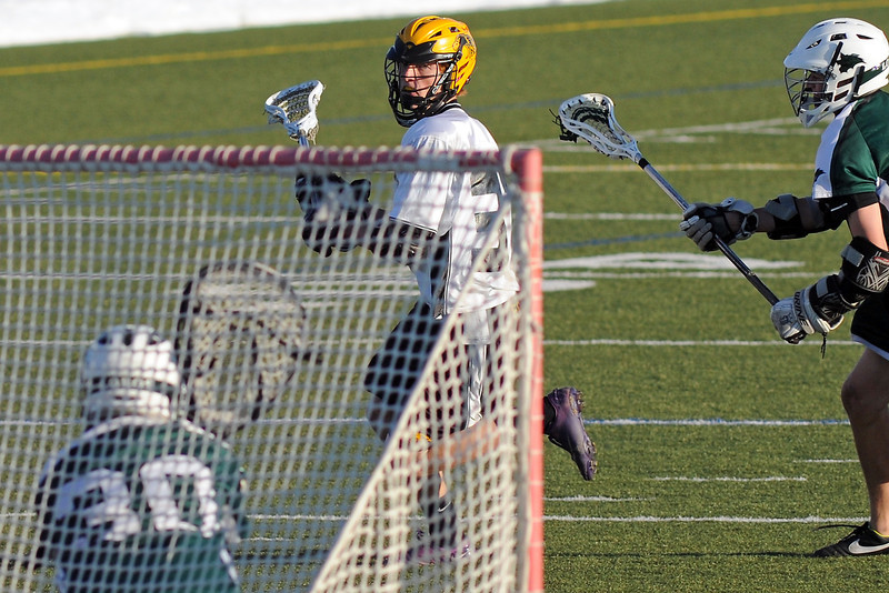 Thompson Valley High School's Eric Houghteling, back left, runs past Conifer's Jack Studer, right, before taking a shot on goalie Alec Lund in the first quarter of their game on Thursday, May 2, 2013 at the Loveland Sports Park.