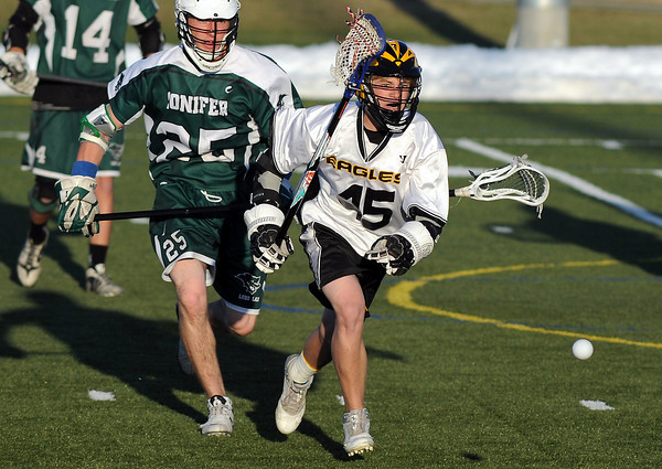 Thompson Valley High School's Kale Wilson, right, and Conifer's Zach Czarnecki track down a loose ball in the second quarter of their game on Thursday, May 2, 2013 at the Loveland Sports Park.