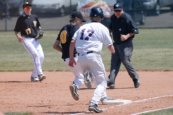 Thompson Valley High School pitcher Garret Smith steps on first base to force out Mountain View batter Kollin Evens while Nate Geifer, left, looks on in the bottom of the third inning of their game Saturday, April 27, 2013 at Brock Field.