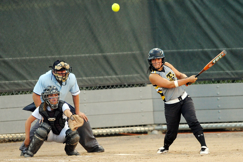 Thompson Valley High School junior Cheyenne Delaney hits a single while Mountain View catcher Ali Reed looks on in the bottom of the fourth inning of their game on Thursday, Aug. 23, 2012 at Centennial Park.