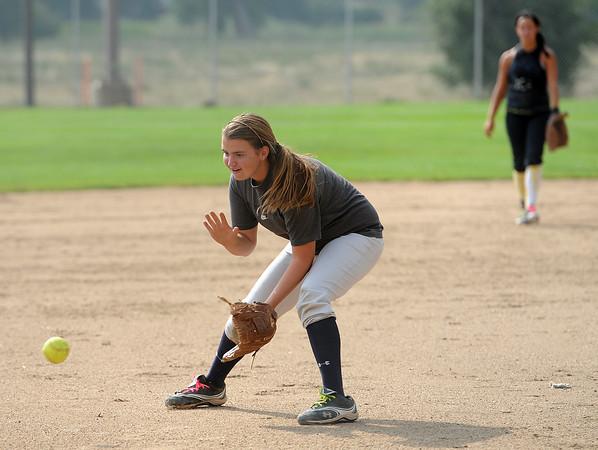 Thompson Valley High School softball pitcher Kinsley Mason during practice on Monday.