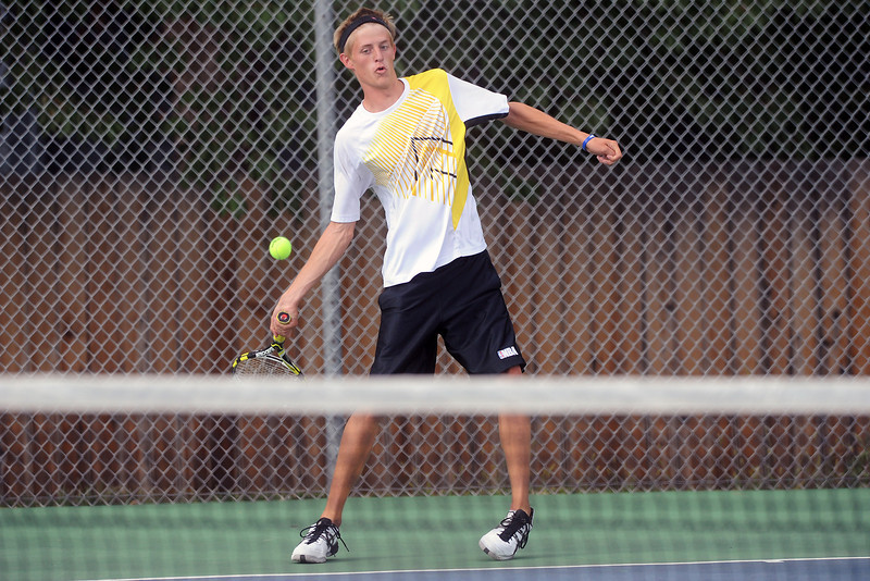 Thompson Valley High School's Logan Bonawitz returns a shot during his match against Cory Winkelhake on Thursday, Aug. 30, 2012 at TVHS.