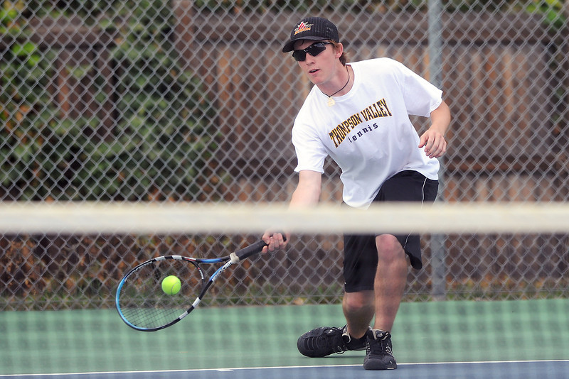 Thompson Valley High School's Nicholas Riffel returns a shot during his match against Loveland's Garet Davis on Thursday, Aug. 30, 2012 at TVHS.