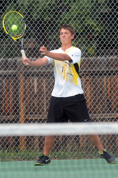 Thompson Valley High School's Jameson Lumpkin returns a shot during his match against Loveland's Joseph Diaz on Thursday, Aug. 30, 2012 at TVHS.