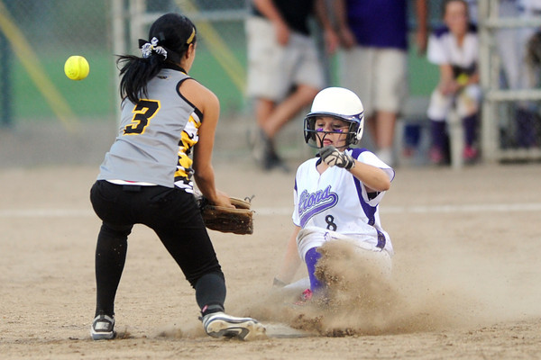 Mountain View High School's Courtney Baeckel slides safely into second base for a steal ahead of the throw to Thompson Valley second baseman Kourtney Walker in the top of the third inning of their game Thursday, Aug. 23, 2012 at Centennial Park.