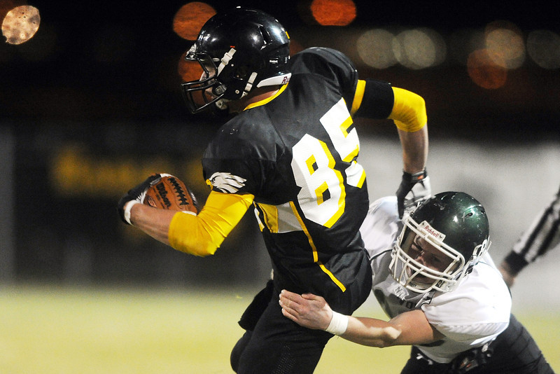 Thompson Valley High School wide receiver Darryn Highland, left, is tackled by Niwot defender Kyle Conarro after a reception in the second quarter of their game on Thursday, Nov. 1, 2012 at Patterson Stadium.