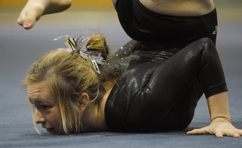 Savannah Carlson of Thompson Valley High School competes during the floor event of the 4A state gymnastics meet at Thornton High School in Thornton.