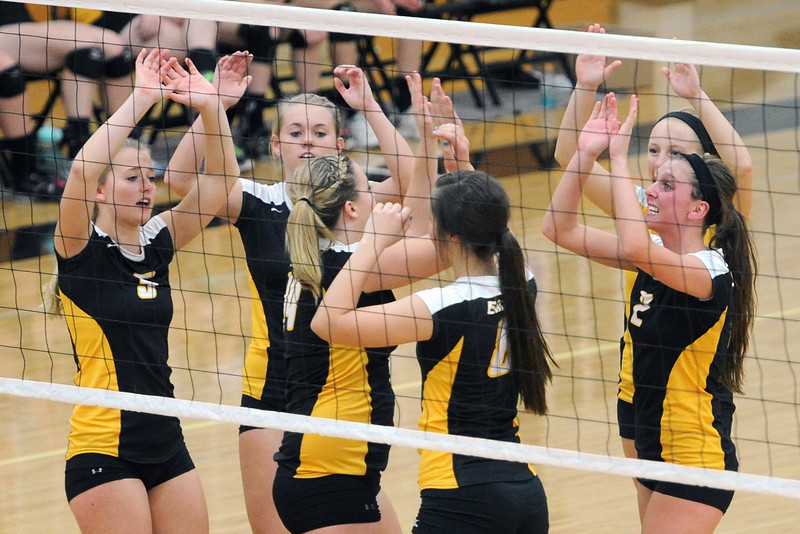 Thompson Valley High School players celebrate after winning a point during set one of a match against Montrose during the Class 4A Region 6 tournament on Saturday, Nov. 6, 2012 at TVHS.