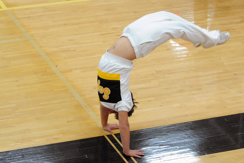 Thompson Valley High School cheerleader Sage D'Ambrosia does backflips in front of the bleachers during a volleyball match against Montrose for the Class 4A Region 6 tournament on Saturday, Nov. 3, 2012 at TVHS.