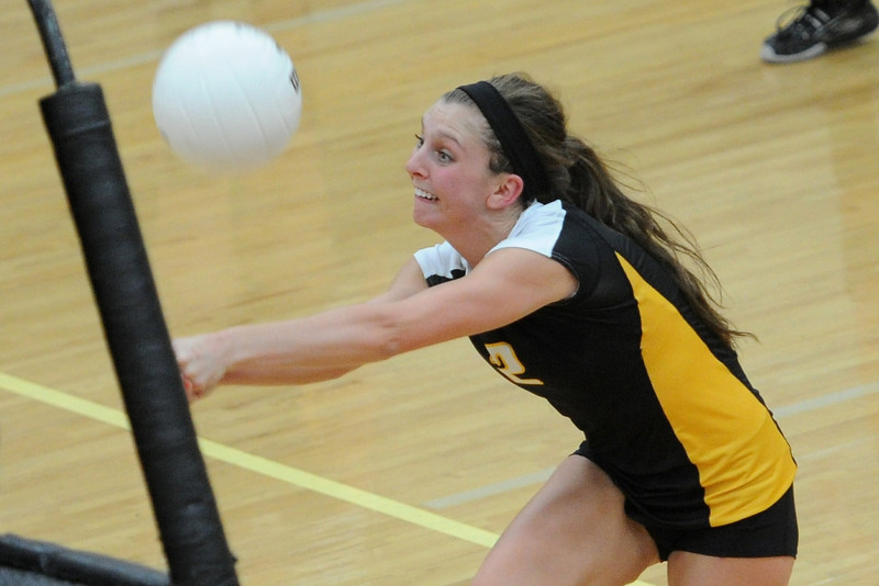 Thompson Valley High School senior Katie Beard makes a dig during set one of a match against Montrose during the Class 4A Region 6 tournament on Saturday, Nov. 3, 2012 at TVHS.