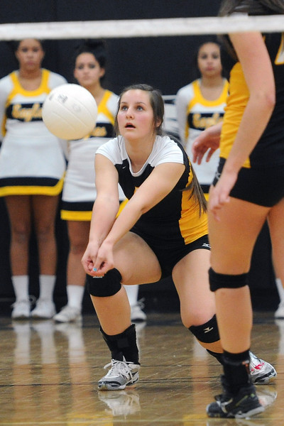 Thompson Valley High School junior Paige Daniels bumps the ball in set one of a match against Montrose during the Class 4A Region 6 tournament on Saturday, Nov. 3, 2012 at TVHS.