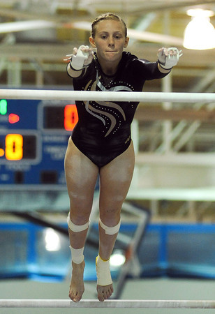 Shaina Burton of Thompson Valley High School competes during the uneven bars event a the 4A state gymnastics meet at Thornton High School in Thornton.