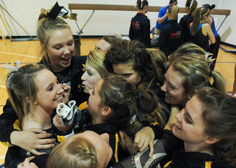 The Thompson Valley High School gymnastics team celebrates a season high score of 174.05 during the 4A state gymnastics meet at Thornton High School in Thornton.