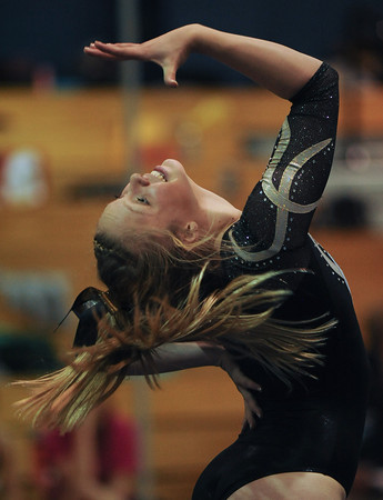 Erin Chavet of Thompson Valley High School competes during the floor event at the 4A state gymnastics meet at Thornton High School in Thornton.