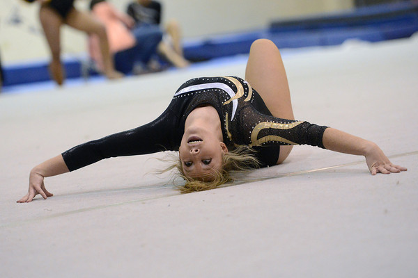 Thompson Valley High School competes in the floor exercise during a dual meet against Loveland on Tuesday, Oct. 2, 2012 at LHS.
