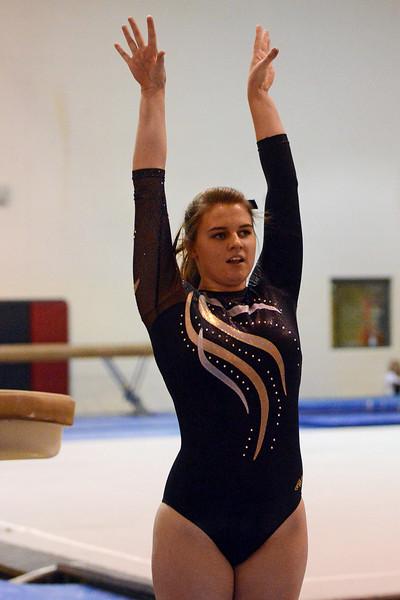 Thompson Valley High School's Emma Applemann performs a vault during a dual meet against Loveland on Tuesday, Oct. 2, 2012 at LHS.