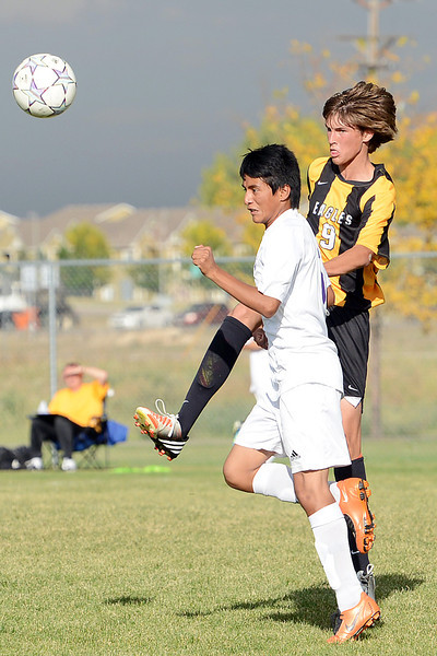 Thompson Valley High School freshman Lucas Beal, right, and Mountain View's Jose Salgado go up for the ball in the first half of their match on Wednesday, Oct. 3, 2012 at MVHS.