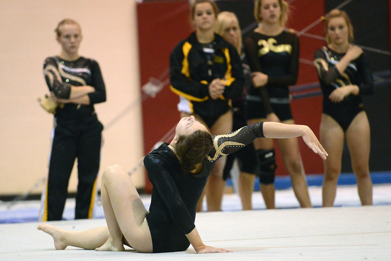 Thompson Valley High School's Corey Fancher performs her floor exercise during a dual meet against Loveland on Tuesday, Oct. 2, 2012 at LHS.