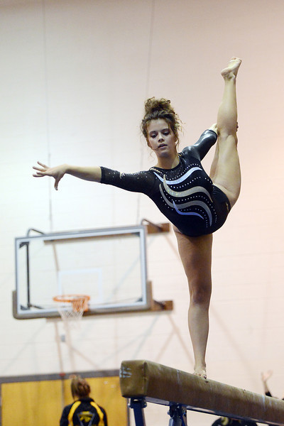 Thompson Valley High School junior Katherine Bosnich performs her routine on the balance beam during a dual meet against Loveland on Tuesday, Oct. 2, 2012 at LHS.