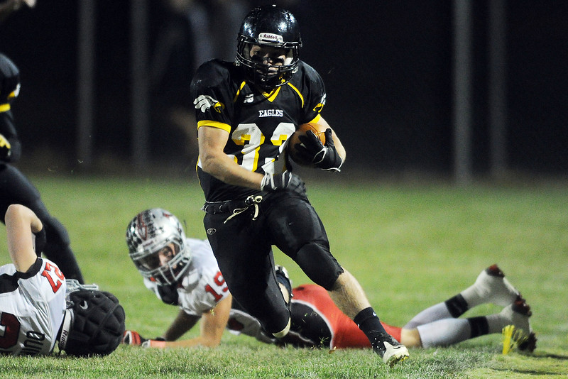 Thompson Valley High School's Ryan Pinn (33) sprints down the sideline on a carry in the second quarter of a game against Loveland on Friday, Oct. 19, 2012 at Patterson Stadium.