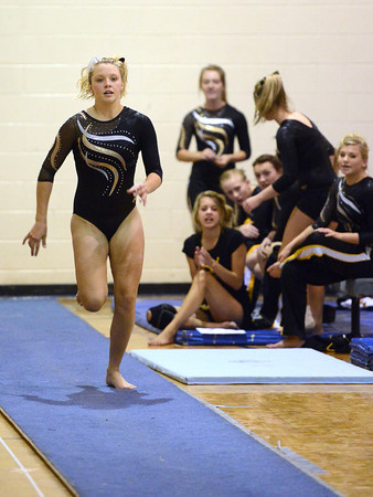 Thompson Valley High School's Erin Chavet performs a vault during a dual meet against Loveland on Tuesday, Oct. 2, 2012 at LHS.